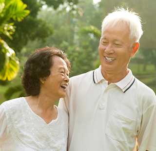 Older Asian woman got her implant supported dentures with a North Penn dentist near Montgomeryville, PA.