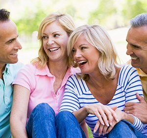Two couples hanging out, both of which got their dental implants in Lansdale, PA.